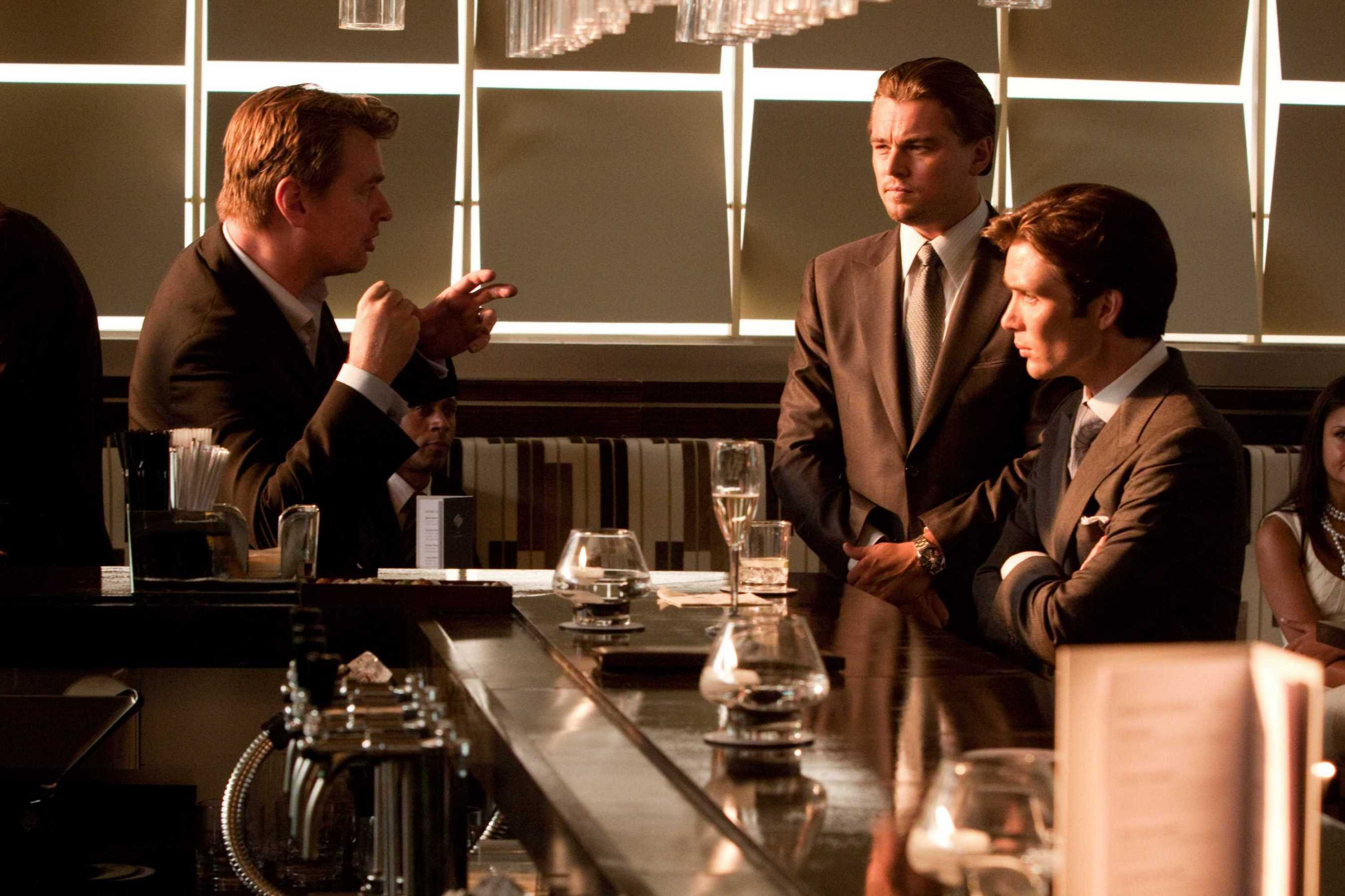 (L-r) Director CHRISTOPHER NOLAN with LEONARDO DiCAPRIO and CILLIAN MURPHY on the set of Warner Bros. PicturesÕ and Legendary PicturesÕ sci-fi action film ÒINCEPTION,Ó a Warner Bros. Pictures release.